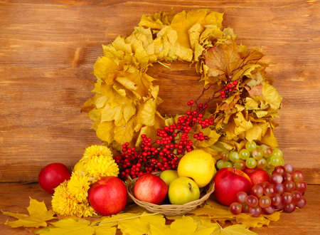 Autumnal composition with yellow leaves, apples and mushrooms on wooden background Stock Photo - 16739822