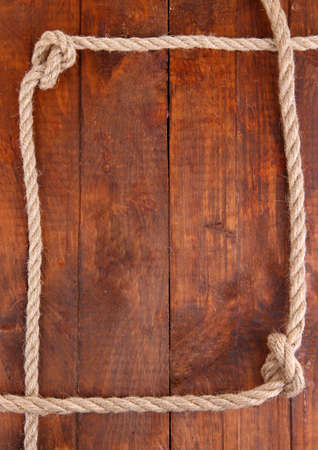 gibbet: Frame composed of rope on wooden background