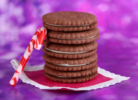 nutritiously: Chocolate cookies with creamy layer on purple background