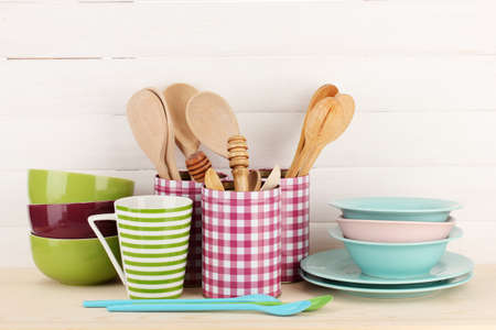 Cups, bowls nd other utensils in metal containers isolated on light background Stock Photo - 16739630