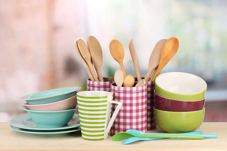 blue white kitchen: Cups, bowls nd other utensils in metal containers isolated on light background