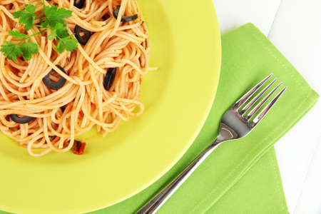 Italian spaghetti in plate on wooden table close-up