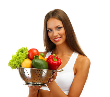 beautiful young woman with vegetables in colander, isolated on white photo