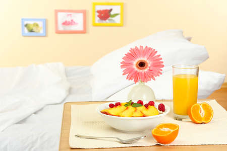 light breakfast on the nightstand next to the bed Stock Photo - 16772398