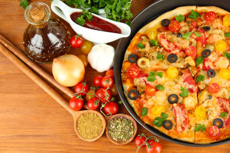 colorful composition of delicious pizza, vegetables and spices on wooden background close-up Stock Photo - 16772644