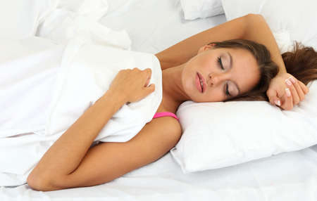 young beautiful woman sleeping in bed Stock Photo - 17281815