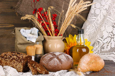 Different types of rye bread on wooden table on autumn composition background Stock Photo - 16772653