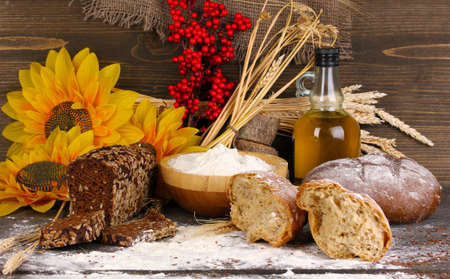 Rye bread on wooden table on wooden background Stock Photo - 16772656