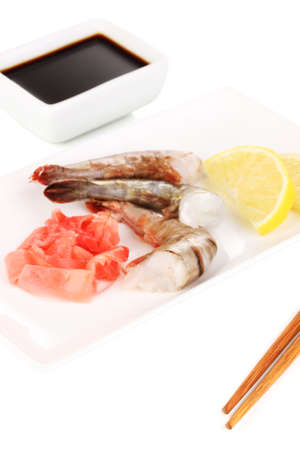 prawn skewers: Prawn skewers on plate with ginger and lemon isolated on white