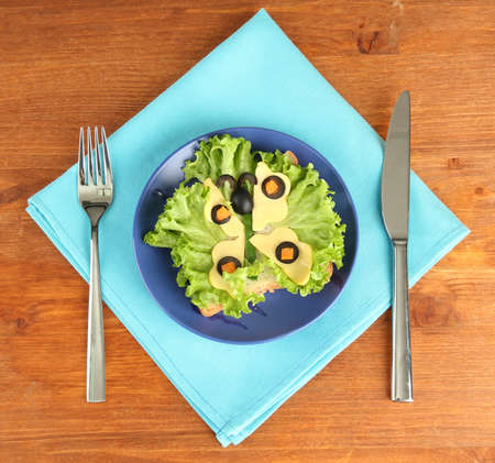 butterfly knife: fun food for kids on wooden background