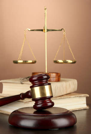 Golden scales of justice, gavel and books on brown background Stock Photo - 16830552