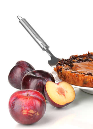 Tasty pie on plate with plums isolated on white Stock Photo - 16830398