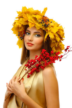 beautiful young woman with yellow autumn wreath and red berries, isolated on white Stock Photo - 17051926