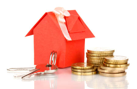 real estate  investment: Small house with money and key isolated on white