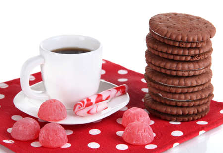 nutritiously: Chocolate cookies with creamy layer and cup of coffe isolated on white