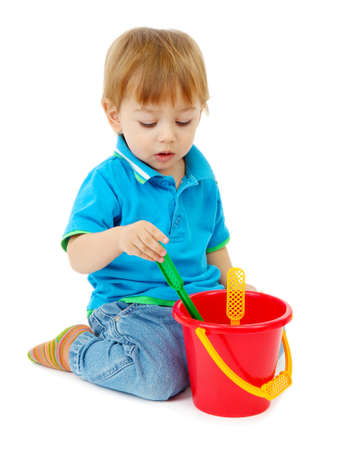 cute little boy with toy bucket, isolated on white Stock Photo