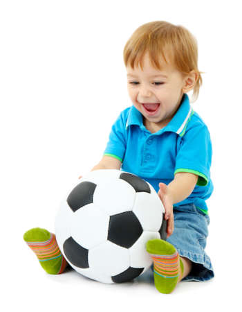 cute little boy with football ball, isolated on white photo