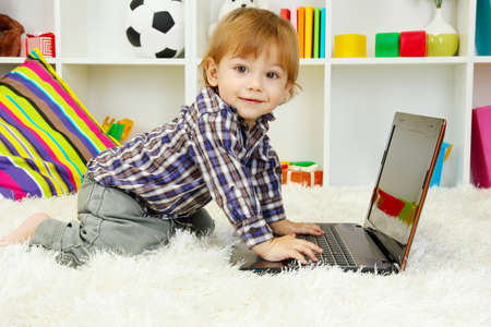 cute little boy and notebook in room Stock Photo - 17761686