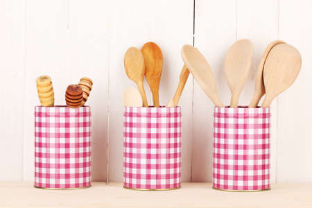 Utensils in metal containers isolated on light background Stock Photo - 16859455