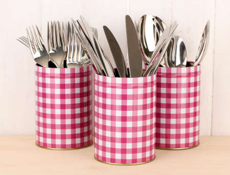 Utensils in metal containers isolated on light background Stock Photo - 16859427