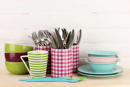 Cups, bowls nd other utensils in metal containers isolated on light background Stock Photo - 16859466