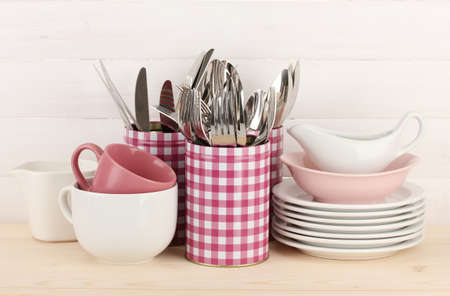 Cups, bowls nd other utensils in metal containers isolated on light background Stock Photo - 16859420