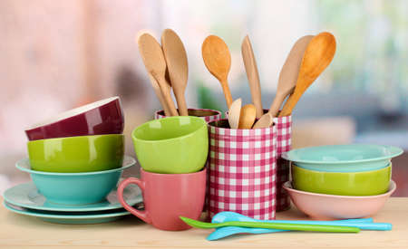 Cups, bowls nd other utensils in metal containers isolated on light background Stock Photo - 16859428