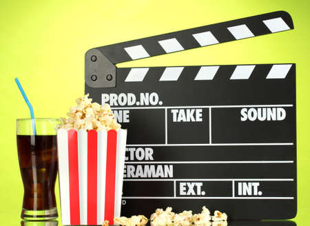 Movie clapperboard, cola and popcorn on background Stock Photo - 16859417