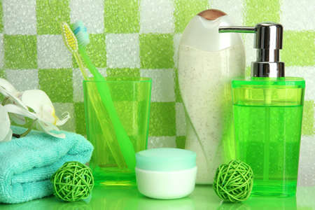 Bath accessories on shelf in bathroom on green tile wall background Stock Photo - 16859562