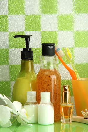 Bath accessories on shelf in bathroom on green tile wall background Stock Photo - 16859560
