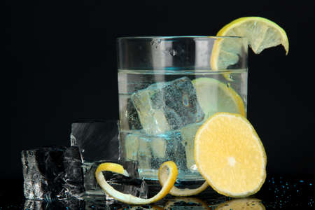 Ice cubes in glass with lemon on dark blue background Stock Photo - 16859480