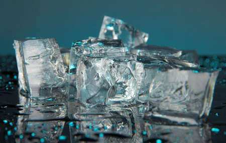 Ice cubes on dark blue background Stock Photo - 16859554