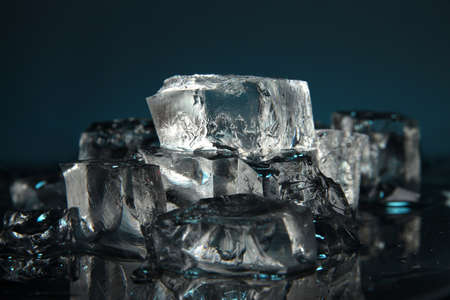 Ice cubes on dark blue background photo
