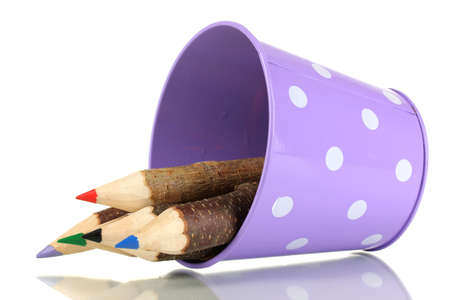 Colorful wooden pencils in purple green pail isolated on white photo