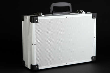 Silvery suitcase on black background Stock Photo - 16859649