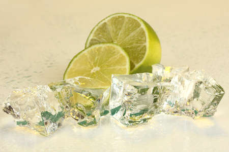 Ice cubes with lime on light yellow background Stock Photo - 16859551