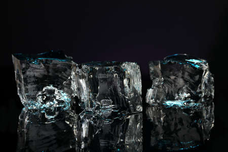 Ice cubes on dark blue background Stock Photo - 16859522