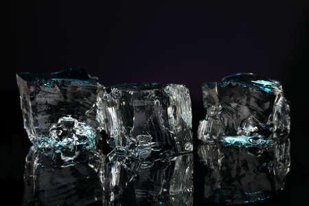 Ice cubes on dark blue background Stock Photo - 16859522