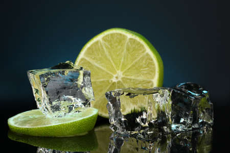 Ice cubes with lime on darck blue background Stock Photo - 16859563