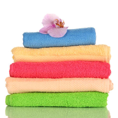 Stack of towels with fragrant flower isolated on white Stock Photo - 16859659