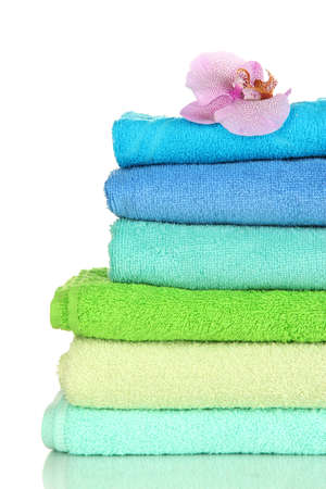 Stack of towels with fragrant flower isolated on white Stock Photo - 16859593