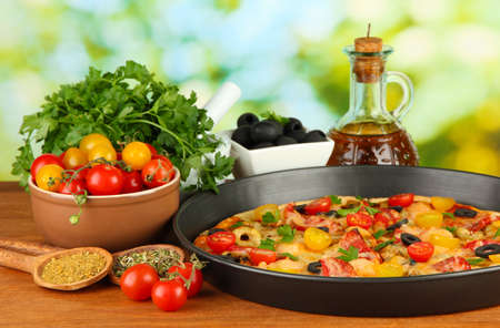 colorful composition of delicious pizza, vegetables and spices on wooden background close-up Stock Photo - 16861040