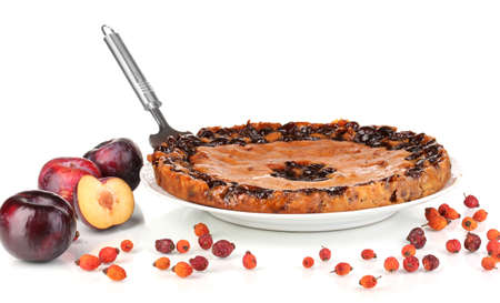 Tasty pie on plate with plums isolated on white Stock Photo - 16860741