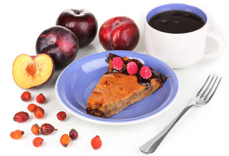 Tasty pie on blue plate with plums isolated on white Stock Photo - 16860875