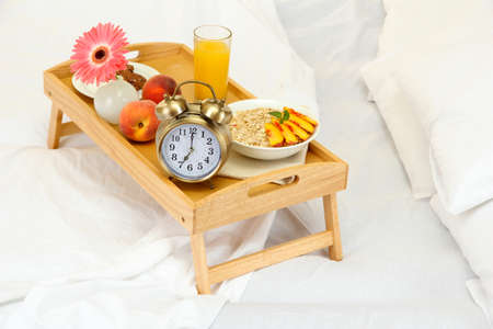 wooden tray with light breakfast on bed Stock Photo - 16895312