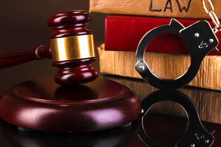 Gavel, handcuffs and books on law isolated on black close-up Stock Photo - 16895341