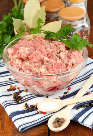 Bowl of raw ground meat with spices on wooden table Stock Photo - 16895446