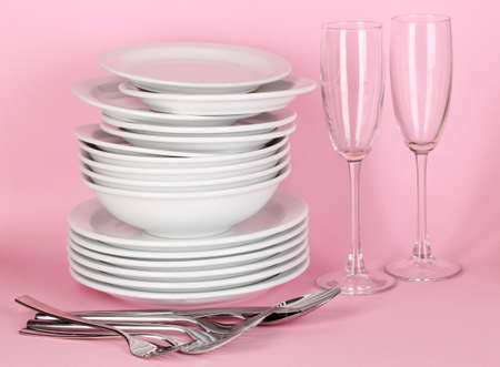 clean dishes: Clean white dishes on pink background