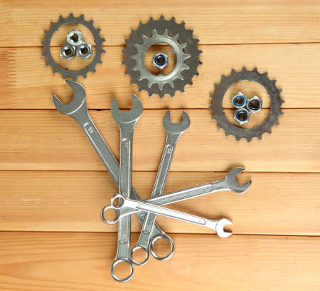 Machine gear, metal cogwheels, nuts and bolts on wooden background Stock Photo - 16911841