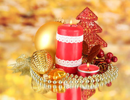 Red candle with christmas decoration on bright background Stock Photo - 16911947